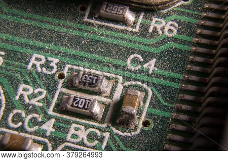 Dusty Printed Circuit Board With Components . Macro