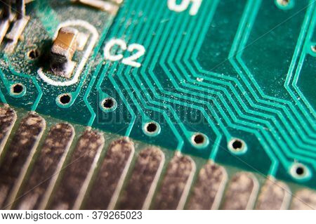 Dusty Printed Circuit Board With Components . Macro Selective Focus