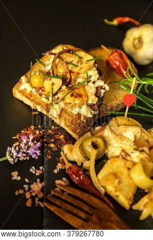 Camembert Marinated In Olive Oil And Spices. Homemade Preparation Of Pickled Cheese With Chili Peppe