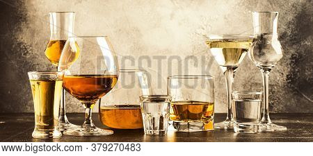 Set Of Strong Alcoholic Drinks In Glasses In Assortment: Vodka, Cognac, Tequila, Brandy And Whiskey,