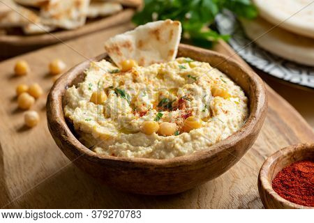 Homemade Chickpea Hummus Bowl With Pita Chips And Smoked Paprika. Closeup View, Square Crop