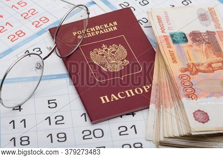The Passport Of The Russian Federation Lies On The Background Of Calendar Numbers, Next To It Lies A