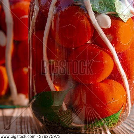 Autumn Harvest Of Red Tomatoes, Horseradish And Garlic In Jars For Preservation