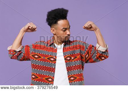 Strong Young African American Guy In Casual Colorful Shirt Posing Isolated On Violet Background Stud