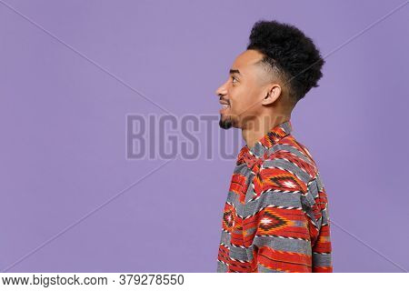 Side View Of Smiling Young African American Guy In Casual Colorful Shirt Posing Isolated On Violet B