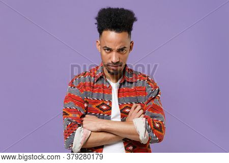 Dissatisfied Young African American Guy In Casual Colorful Shirt Posing Isolated On Violet Backgroun