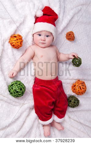 Little Santa Claus With Toys Lying On A White Background.