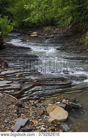Beautiful Small Mountain River  Among The Green Forest. Carpathian Flysch Belt. Carpathians. Ukraine