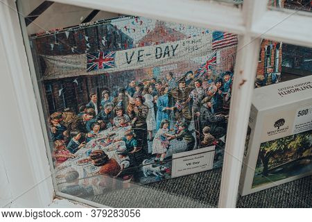 Broadway, Uk - July 07, 2020: Ve Day Themed Puzzles On Sale In A Window Of A Shop In Broadway, A Lar