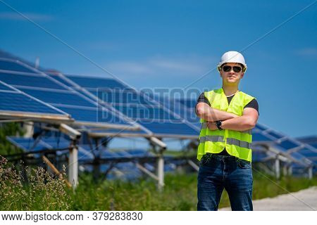 Engineer On A Solar Plant. Green Energy. Electricity. Power Energy Pannels.