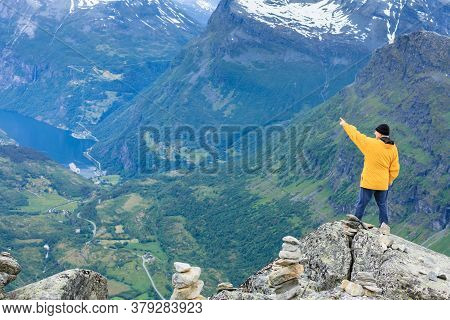 Tourism Vacation And Travel. Male Tourist Enjoying Geirangerfjord And Mountains Landscape From Dalsn