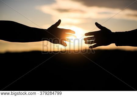 Friendly Handshake, Friends Greeting, Teamwork, Friendship. The Outstretched Hands, Salvation, Help