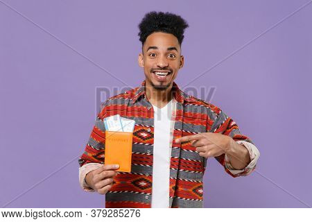 Funny African American Guy In Colorful Shirt Traveling Abroad Isolated On Violet Background. Air Fli