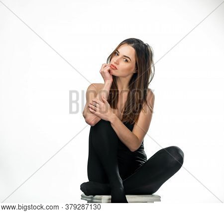 Elegant Beautiful Slim Woman In Black Top, Leggins. Posing Over White Background. Fashionable Trennd