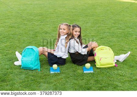 In Friendship There Is Happiness. Happy Children Enjoy Friendship. School Friends Sit On Green Grass