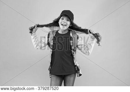 Her Own Hairdresser. Happy Girl Hold Long Hair Pink Background. Kids Hairdresser. Hairdresser Salon