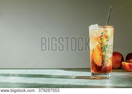 Refreshing Peach Iced Tea Cuba Libre Or Long Island Iced Tea Cocktail In Glass With Straw. Summer Re
