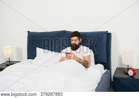 Check Email. First Of All. Bearded Man Texting Sms In Bed. Hipster Send Message Using Smartphone. Mo