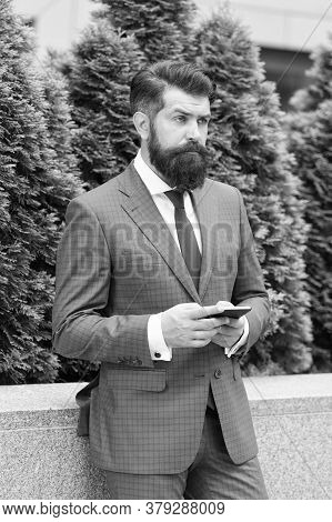 Concentrated On Work. Confident Man Standing Outdoors At The City Street. Mature Bearded Man At Cypr