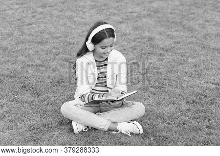 Write Song Lyrics. Happy Childhood Concept. Kid Write Memory In Diary. Schoolgirl Relax With Noteboo