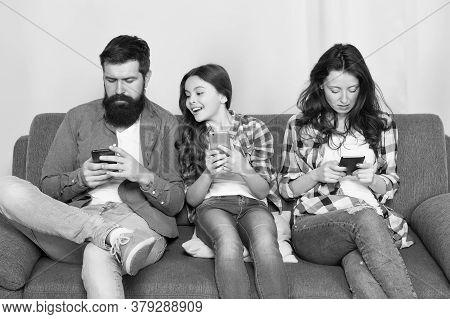 Mom Dad And Daughter Relaxing On Couch. Family Leisure. Play Game Application. Online Family. Family