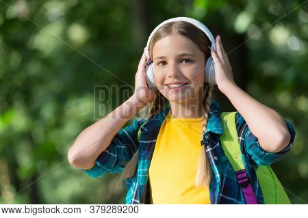 Take Your Headphones Wherever You Go. Happy Child Wear Headphones Natural Outdoors. Listening To Mus