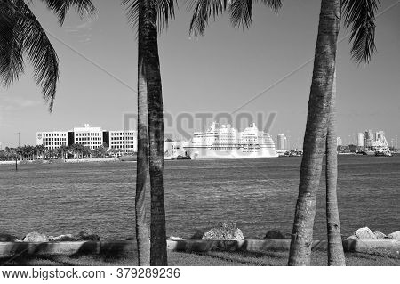 Miami, Usa - February 29, 2016: Seven Seas Navigator On Deep Blue Water And Sky With Palms Foregroun