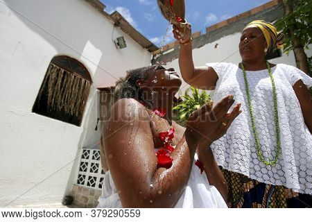 Salvador, Bahia / Brazil - February 12, 2015: Mother Of Saints From Candomble Makes A Sacred Bath In