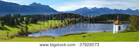 panorama view over beautiful rural landscape and alps mountains nearby city Fuessen in Bavaria Germany poster