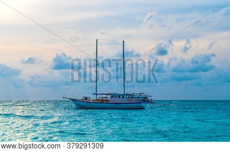A Pier In A Tropical Island. Yachts In A Turquoise Lagoon. Maldives Holiday