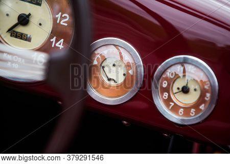 Close Up Shot Of A Vintage Car's Oil Pressure Gauge An Analogue Clock.