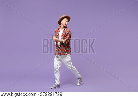 Smiling Young African American Guy In Casual Colorful Shirt Hat Posing Isolated On Violet Background