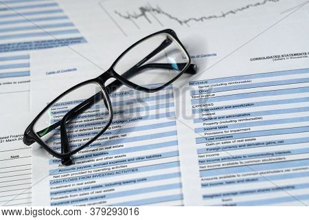 Glasses And Business Report And Financial Statement.