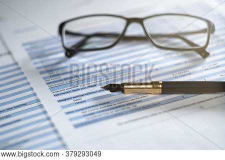 Balance Sheet In Stockholder Report Book With Glasses And Pen, Balance Sheet Is Mock-up