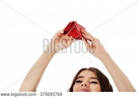 Beautiful caucasian business woman checking her empty red wallet. Isolated on white.