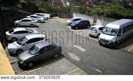 Salvador, Bahia / Brazil - July 29, 2020: Vehicles Are Seen In Condominium Parking Lot In The City O