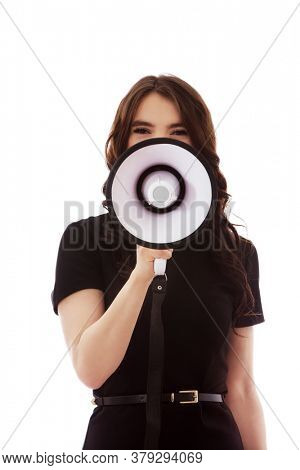 Young businesswoman yelling and shouting over megaphone