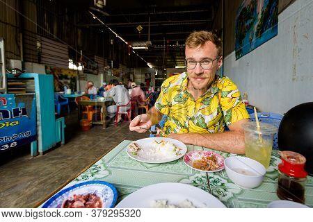 Handsome Caucasian Man In Local Vietnamese Restaurant