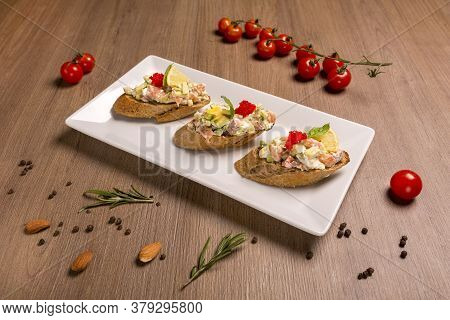 Bruschetta With Salmon And Avocado Dried Rye Baguette, Cream Cheese, Salmon, Tobiko Caviar, Avocado,