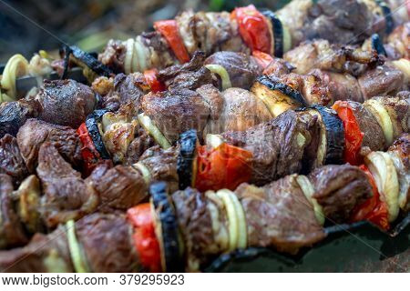 Skewers Uncooked In Nature On Skewers In The Open Air. Shish Kebab On The Nature Raw On The Grill On