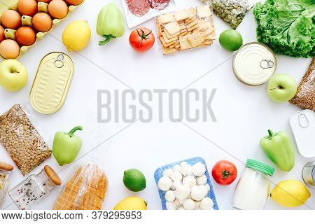 Set Of Grocery Items From Canned Food, Vegetables, Cereal On White Bacground. Food Delivery Concept.