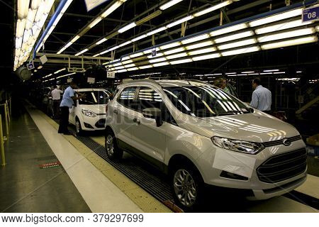 Camacari, Bahia / Brazil - December 12, 2013: Workers Are Seen On The Assembly Line At The Ford Fact
