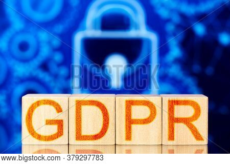 Gdpr. Wooden Blocks With The Inscription Gdpr On The Background Of Lock And Gears