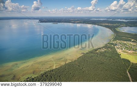Big Lake In Forest Background