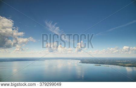 Blue Color Lake With Cloudscape
