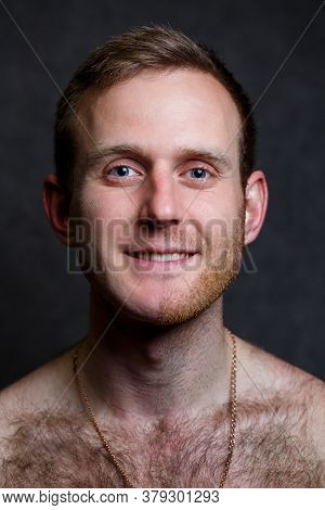 Young Man Shaving His Beard. He Shaved Off Half The Bristles Against A Gray Background. Male Face Ca