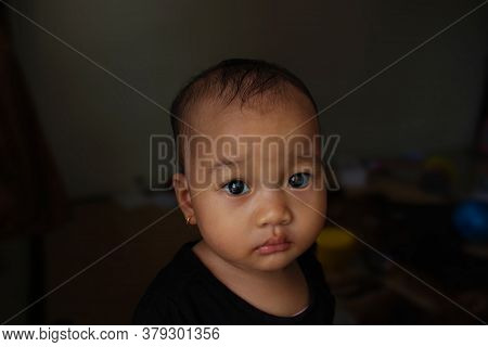 A Beautiful Cute Indonesian Baby With Pleading Look