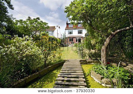 Large backyard English style garden