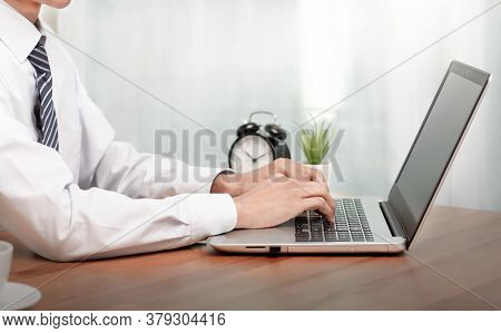 Coronavirus.business Man Working On Laptop Computer  At Home While Sitting The Wooden Table.male Han