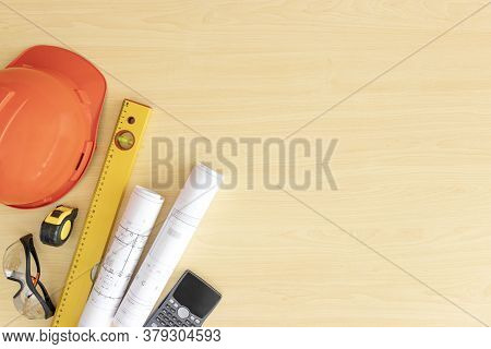 Top View Engineer Desk Light Brown Wood Texture Have Roll Home Plan And Tools, Measuring Tape , Calc
